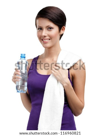 Athletic woman with bottle of water and bath towel, isolated on white