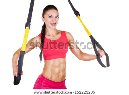 Athletic woman with functional loops for training isolated on white background - stock photo