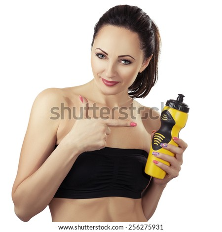 athletic woman with sport bottle. Isolated on white background  - stock photo