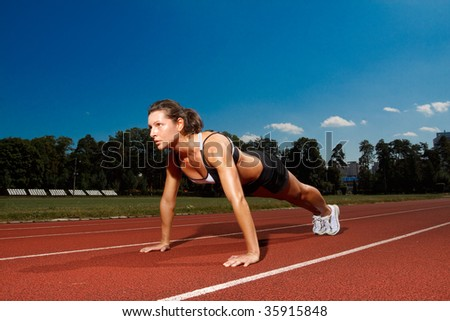 Athletic woman working out on track - stock photo