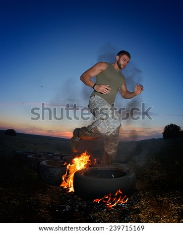 athletic young man exercising on dusty field - stock photo