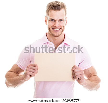 Athletic young man holding card with copyspace - isolated on white - stock photo
