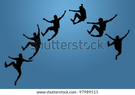 Athletic young man leaping in the air clicking his heels together, silhouette on gradient blue; concept of success, joy, reaching high, enjoyment of life