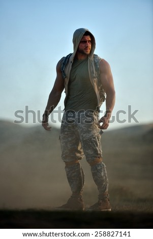 athletic young man on dusty field - stock photo