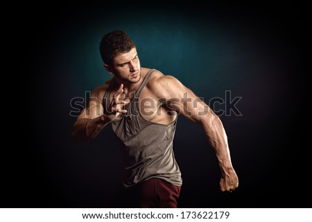 athletic young man portrait in studio