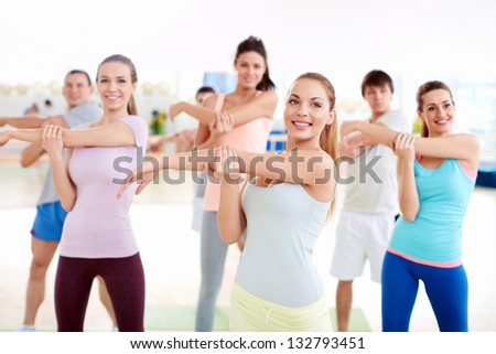 Athletic young people at the gym - stock photo