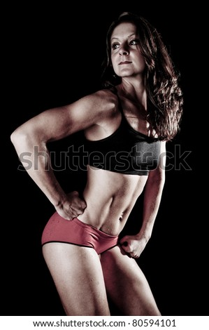 Athletic Young Woman Flexing Muscles - stock photo