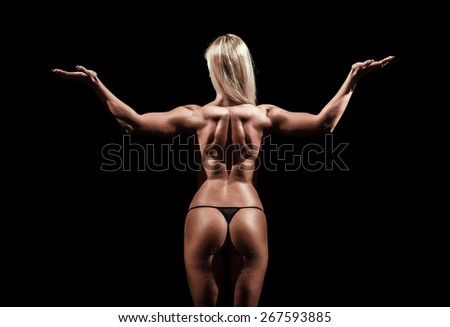 Athletic young woman on a isolated black background - stock photo