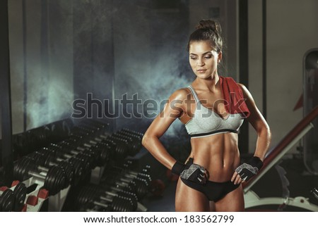 athletic young woman resting during exercise in the gym - stock photo