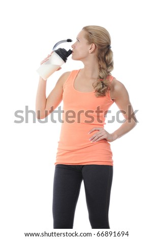 athletic young woman with protein shake bottle. Isolated on white background - stock photo