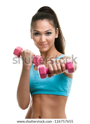 Athletic young woman works out with pink dumbbells, isolated on white - stock photo