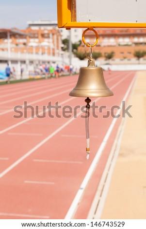 Athletics bell announcement last lap - stock photo