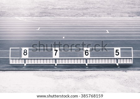 Athletics long jump sand pit with marks - stock photo
