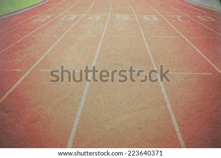 Athletics stadium running track  paper picture - stock photo