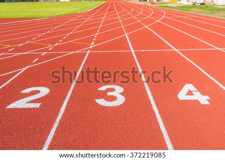 Athletics stadium with the numbering. Running track - stock photo