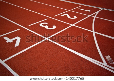 Athletics Start track lanes 1 2 3 of a red running racing track