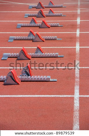 Athletics Starting Blocks on a red running track in the stadium. - stock photo