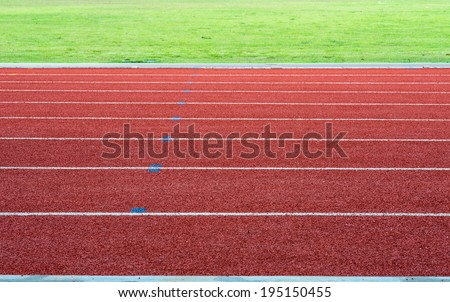 Athletics Track Lane with grass - stock photo