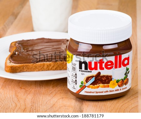 ATLANTA - APRIL 23, 2014: Jar of Nutella, toast with Nutella spread and milk to drink.  - stock photo