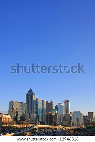Atlanta cityscape at dusk - lots of sky space for tect - stock photo