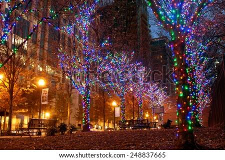 ATLANTA, GA - NOVEMBER 25:  Colorful holiday lights adorn trees along Peachtree Street in midtown, on November 25, 2014 in Atlanta, GA.  - stock photo