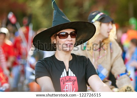 ATLANTA, GA - OCTOBER 20:  A woman in a witch hat walks in the Little Five Points Halloween parade on October 20, 2012 in Atlanta. - stock photo