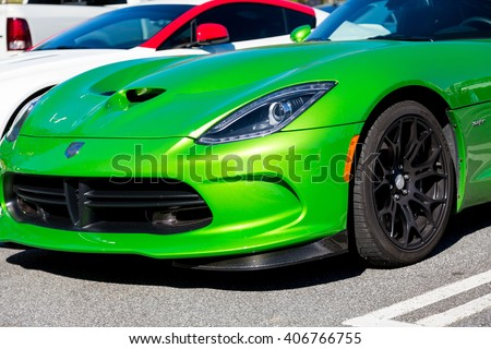 ATLANTA, GEORGIA - April 3, 2016: Caffeine and Octane is a nationally recognized car show held monthly, displaying hundreds of classic and muscle cars at Perimeter Mall. - stock photo