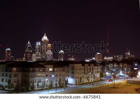 Atlanta Georgia Skyline at night with condos in foreground - stock photo