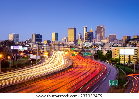 Atlanta, Georgia, USA downtown city skyline over the interstate highway. - stock photo