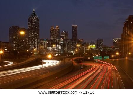 Atlanta skyline and highway at  night - stock photo