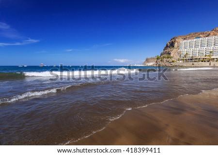 Atlantic beach of Gran Canaria island in Taurito, Spain - stock photo