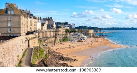Atlantic beach under the walled city of St Malo, Brittany, France - stock photo