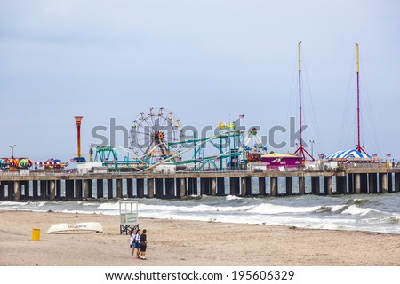 ATLANTIC CITY - JULY 13: View in the evening to famous Steel Pier on July 13, 2010 in Atlantic City, USA. Atlantic City's Steel Pier is sold for $4.25 million in AUG 2011 to Catanoso family. - stock photo