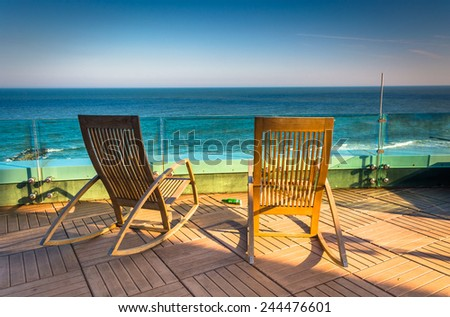 ATLANTIC CITY - MAY 30: Chairs on a balcony at Revel Casino Hotel on May 30, 2014, in Atlantic City, New Jersey. Revel is the tallest building in Atlantic City and a popular casino and resort. - stock photo