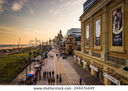 ATLANTIC CITY - MAY 30: View of the boardwalk at sunset on May 30, 2014, in Atlantic City, New Jersey. Atlantic City is a resort city known for its casinos. - stock photo