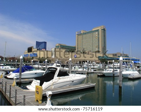 ATLANTIC CITY, NEW JERSEY - APRIL 20: Trump Marina Hotel in the Marina section of Atlantic City, on April 20, 2011. The resort opened in 1985 and includes the 640 slip Frank S. Farley State Marina. - stock photo