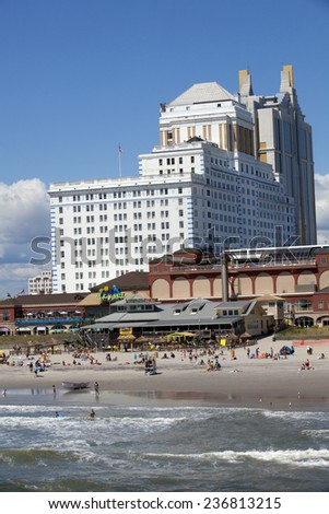 Atlantic City, New Jersey, USA - Aug 24, 2014: Tourist enjoying a nice summer day of the Resorts Hotel and Casinos with Margaritaville restaurant in Atlantic City, New Jersey, USA on Aug 24, 2014 - stock photo