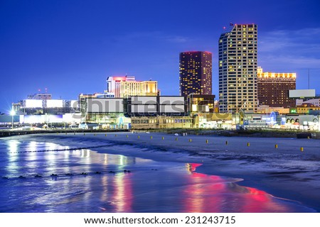 Atlantic City, New Jersey, USA resort casinos cityscape on the shore at night. - stock photo
