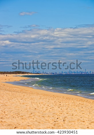 Atlantic Ocean shore at Sandy Hook with a view to NYC. Sandy Hook is in New Jersey, USA. - stock photo