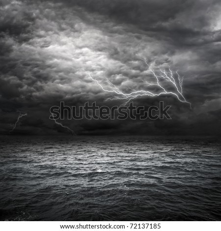 Atlantic Ocean Storm setting in. Lightning over storm clouds above the sea. - stock photo