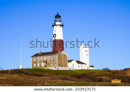 Atlantic ocean waves on the beach at Montauk Point Light, Lighthouse,, Long Island, New York, Suffolk County in Winter - stock photo