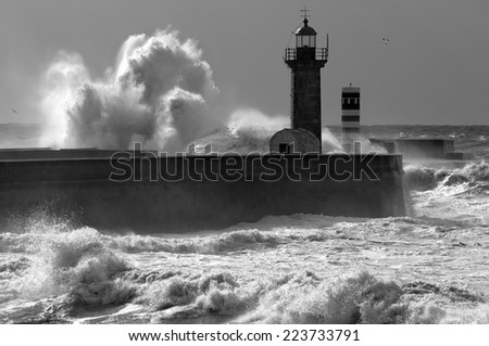 Atlantic stormy waves at the entrance of an harbor. - stock photo
