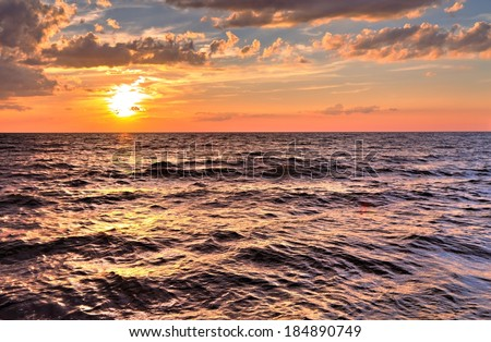 Atlantic Sunset. Sunset background looking over Atlantic Ocean horizon. - stock photo