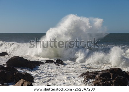Atlantic waves on coastal stones at Porto city, Portugal.
