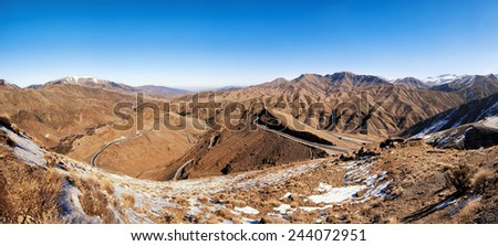 Atlas mountains covered with snow panorama, Morocco. - stock photo