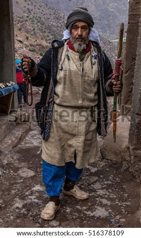 Atlas Mountains, Morocco, circa November 2016.Barber man in a tiny settlement of Sidi Chamharouch in Atlas.