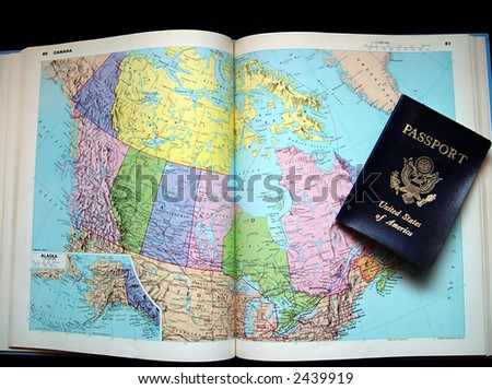 Atlas opened to United States along with a US passport. - stock photo