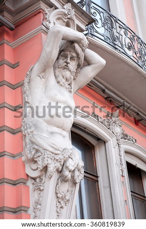 Atlas sculpture closeup on old building facade in St. Petersburg, Russia - stock photo