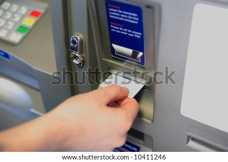 ATM Access -  Female hand inserts banking card