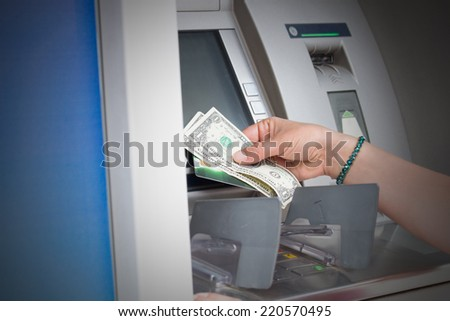 ATM cash withdrawal. - stock photo